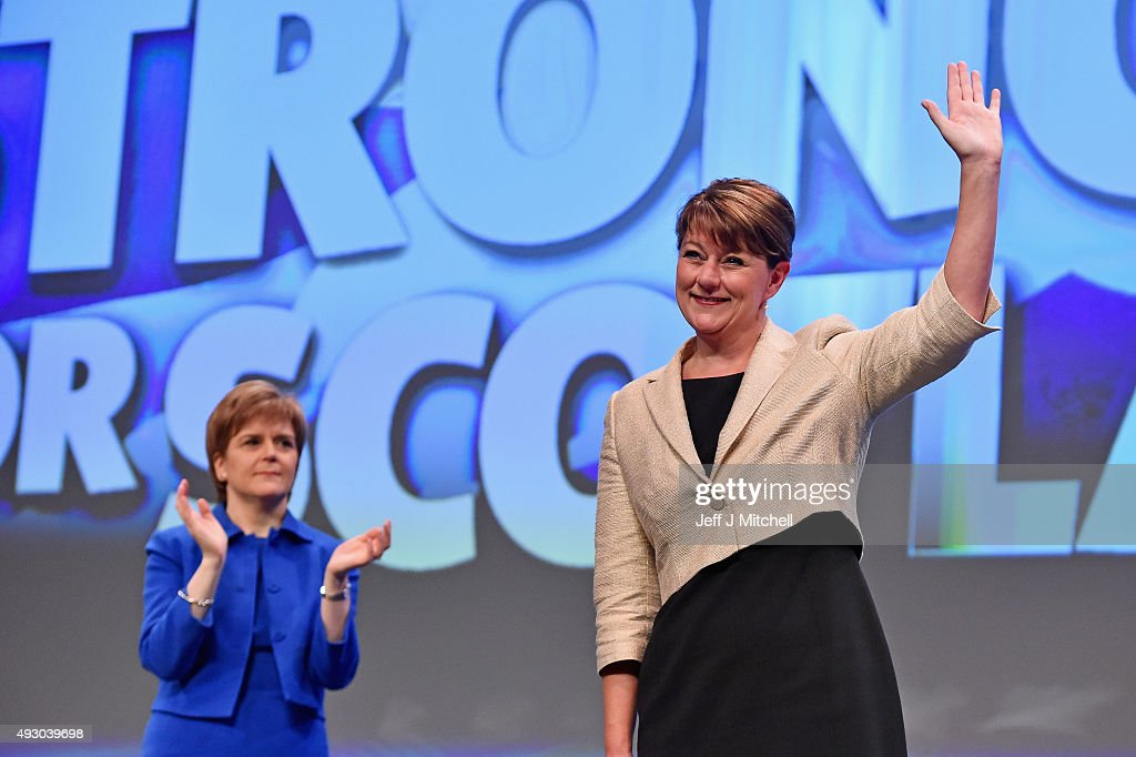 Leanne Wood (R), the Plaid Cymru leader acknowledges applause from Nicola Sturgeon following her address during the 81st annual SNP conference at the Aberdeen Exhibition and Conference Centre on October 17, 2015 in Aberdeen, Scotland. Leanne Wood told delegates at the SNP conference in Aberdeen today that Wales needs to learn lessons from Scotland as she attacked Labours record.