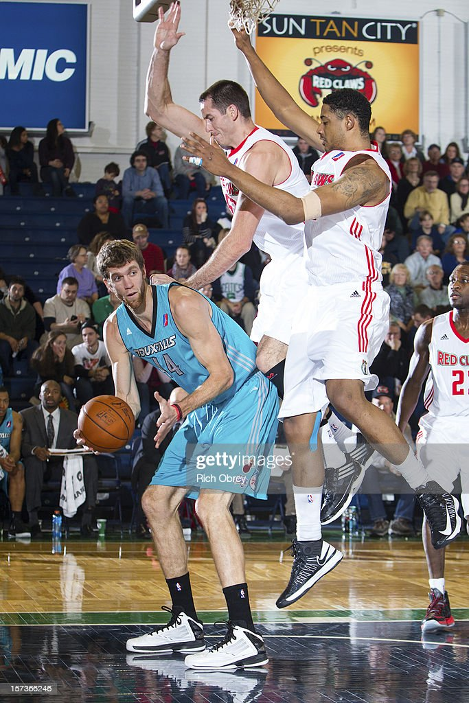 Leaping defense by Chris Ayer #50 and Fab Melo #41 of the Maine Red Claws forces a pass by Will Foster #44 of the Sioux Falls Skyforce on December 2, 2012 at the Portland Expo in Portland, Maine.