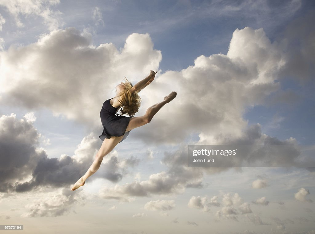 Leaping Woman Dancer Into The Sky : Stock Photo