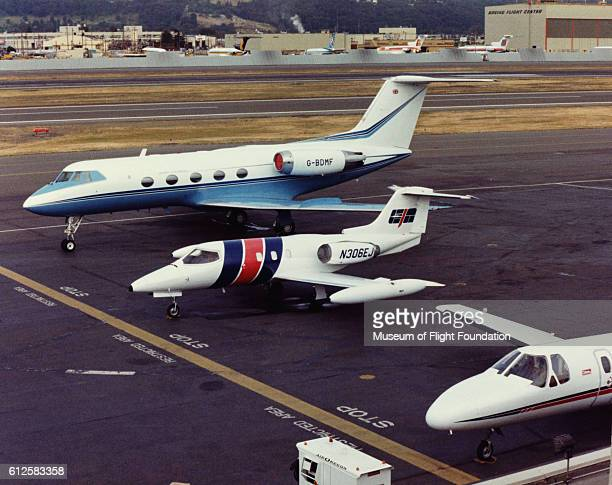 A Lear Aircraft Learjet business transport sits between a Grumman Gulfstream II and a Cessna Citation at Boeing Field in Seattle Washington
