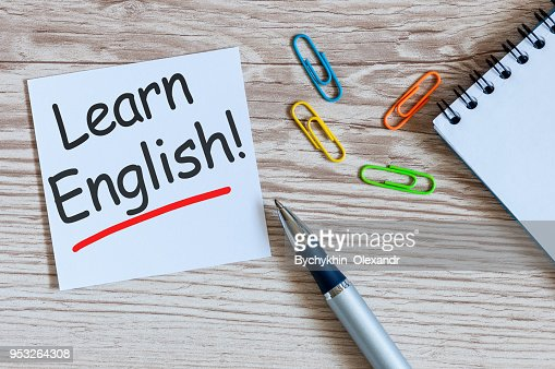 Learn english - note at wooden background with teachers glasses : Stock Photo