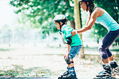 Cute little boy learning to roller blade