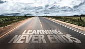 Learning Never Ends written on rural road