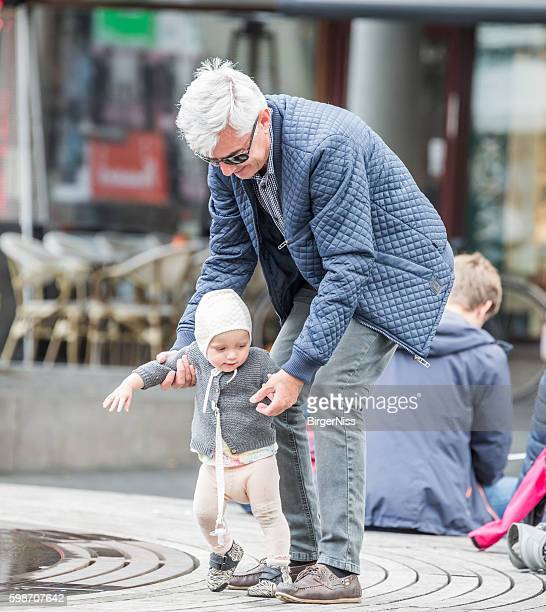 Learning to walk with grandpa, Copenhagen, Denmark