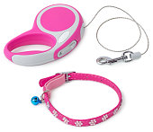 Pink retractable leash for dog and jeweled collar with bell isolated on white background