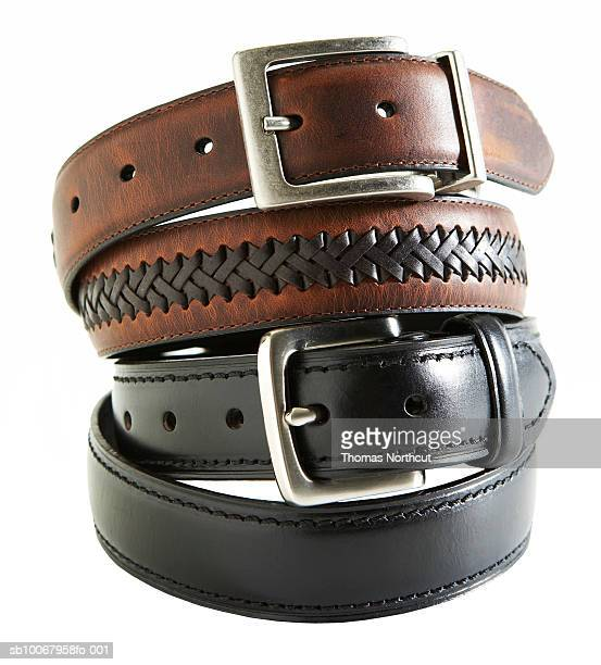 Leather belts on white background