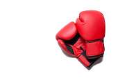 Leather box equipment for fight and training. Pair of boxing gloves lying on each other. Combat and fight concept. Boxing gloves in red color isolated on white background.