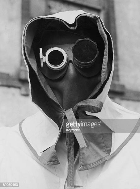 A leather face mask goggles and a hood are deemed adequate protection against radioactivity during nuclear testing circa 1960