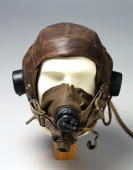 Leather flying helmet with 10A/12401 headphones an oxygen mask and a 10A/12570 microphone At the outbreak of WWII flying helmets had changed little...