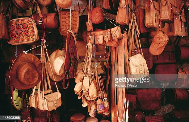 Leather goods for sale at shop in Bhatia Market.