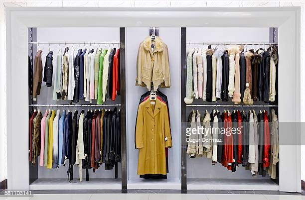Leather jackets hanging in a store