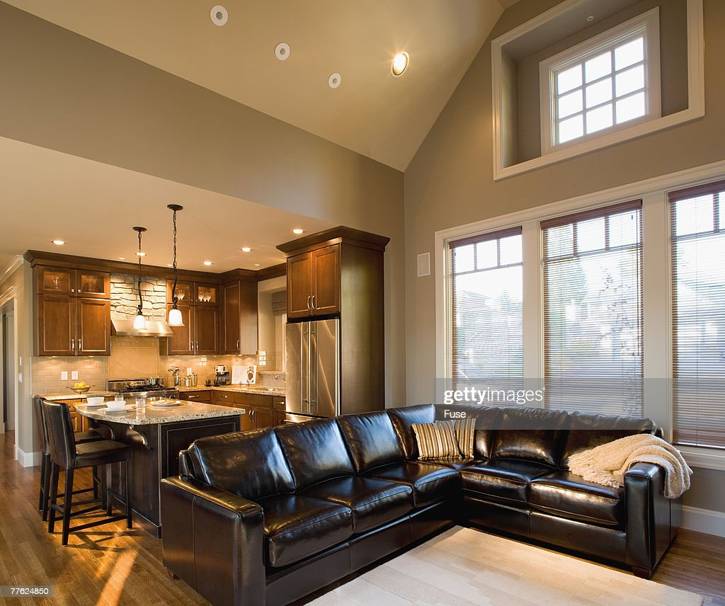Leather Sectional Sofa in Family Room by Kitchen  Stock Photo : kitchen sectional - Sectionals, Sofas & Couches