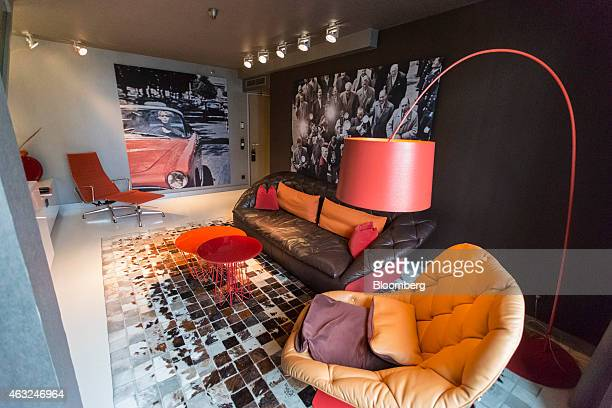 A leather sofa and armchair stand on floor tiles in a family suite guest room inside a Sofitel luxury hotel operated by Accor SA in Munich Germany on...