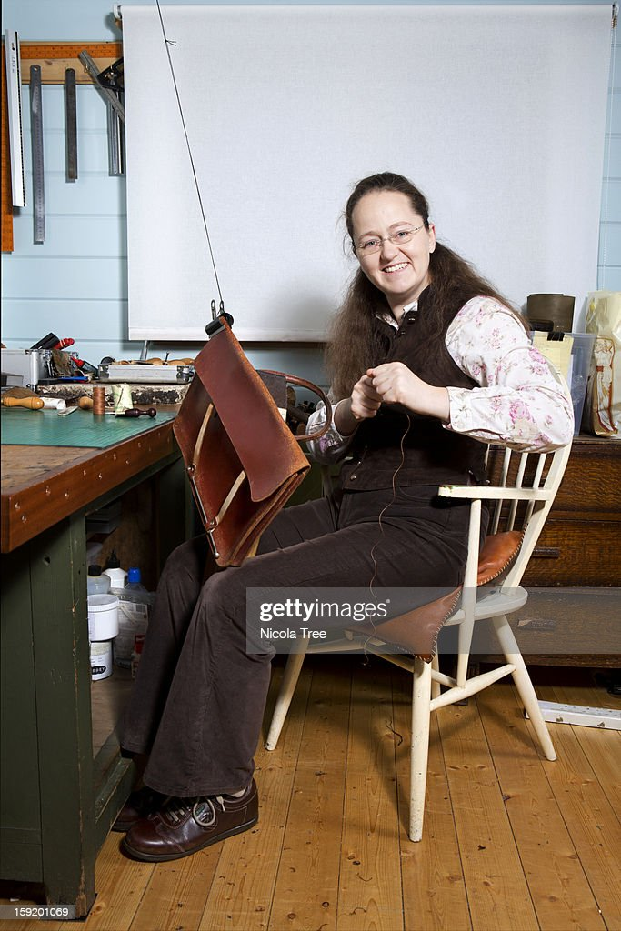 Leather stitcher and Saddler : Stock Photo
