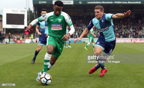 Leatherhead's D'Sean Theobald and Wycombe Wanderers' Adam ElAbd during the Emirates FA Cup second round match at Adams Park Wycombe
