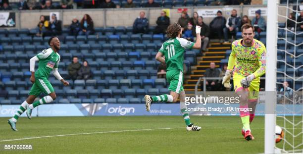 Leatherhead's Jack Midson celebrates after he scores the opening goal from the penalty spot during the Emirates FA Cup second round match at Adams...
