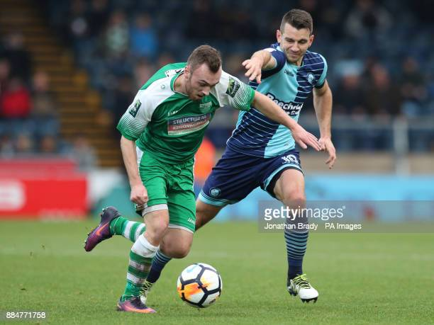 Leatherhead's Niall McManus is tugged back by Wycombe Wanderers' Matt Bloomfield during the Emirates FA Cup second round match at Adams Park Wycombe