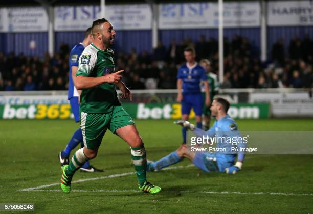 Leatherhead's player manager Sammy Moore celebrates scoring his sides third goal during the FA Cup 1st Round Replay at the AGP Arena Billericay