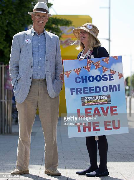 A Leave campaigner holds a placard that reads 'Choose Freedom Leave the EU' in ClactononSea as UK Independence Party leader Nigel Farage visits on...