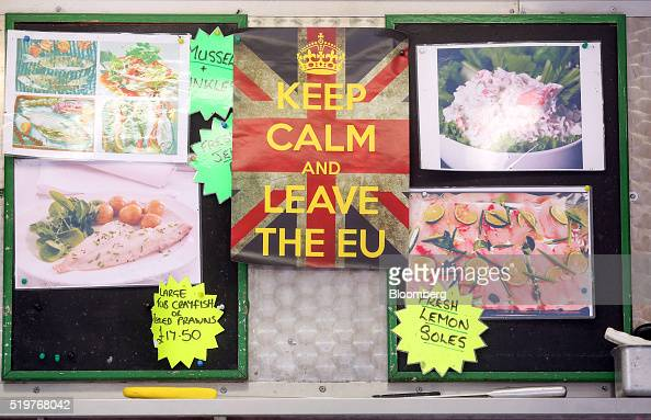 A leave EU campaign poster which reads 'Keep Calm and Leave The EU' hangs behind Dave Crosbie's fishmonger stall at the market in Romford UK on...