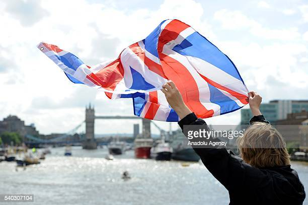 A leave supporter is seen as fishing boats campaigning for Brexit sail down the Thames through central London United Kingdom on June 15 2016 A Brexit...