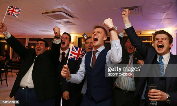 LeaveEU supporters wave Union flags and cheer as the results come in at the LeaveEU referendum party at Millbank Tower in central London early in the...