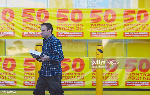 A leaves after making a purchase in a JB HiFi store on May 28 2015 in Melbourne Australia Forecasters predict the tax breaks for small business...