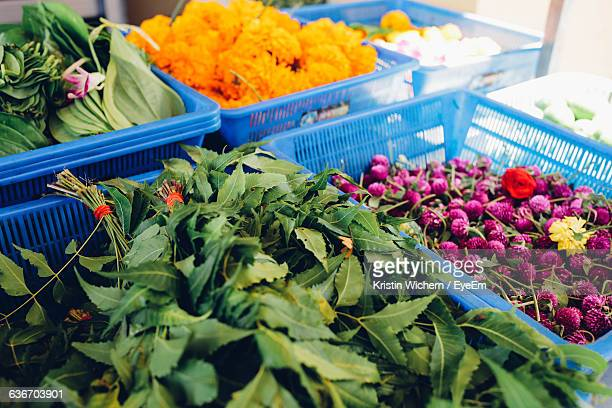 Leaves And Flowers In Crates At Market