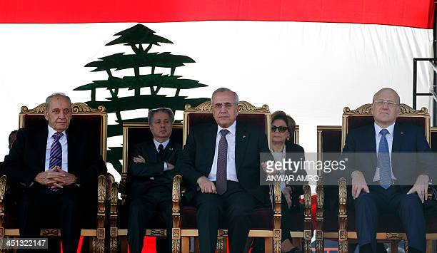 Lebananese President Michel Sleiman caretaker prime minister Najib Mikati and Parliament Speaker Nabih Berri watch a parade in the capital Beirut to...