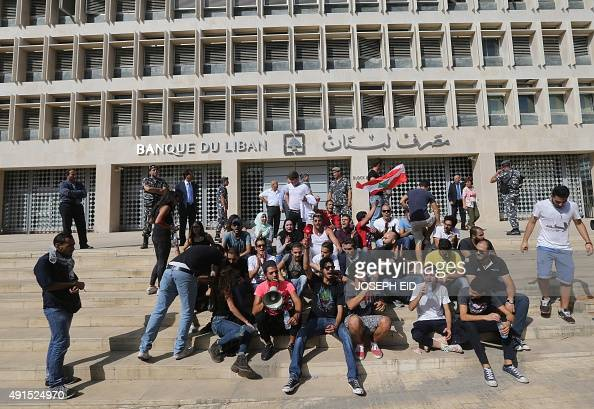Lebanese activists from the socalled 'You Stink' campaign demonstrate outside the country's central bank in Beirut on October 6 calling on the...