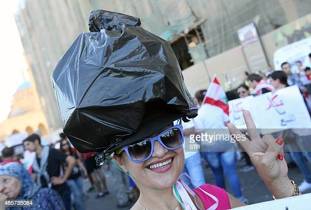 A Lebanese activists wears a rubbish bag over her head during a mass rally against a political class seen as corrupt and incapable of providing basic...