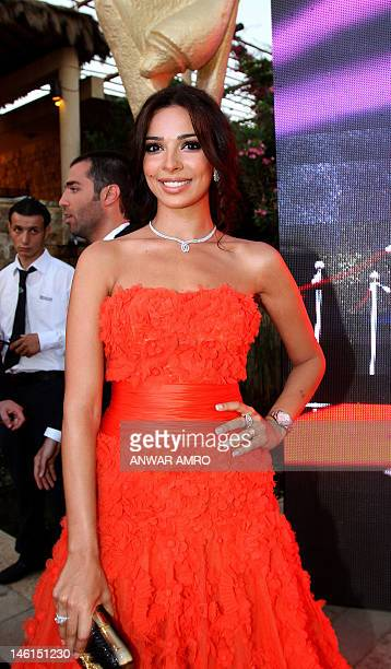 Lebanese actress Nadine Njeim arrives at the 2012 Murex d'Or awards ceremony in the ancient Lebanese port of Byblos north of the capital Beirut on...