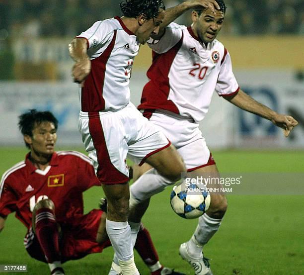 Lebanese Ali Nasseredine and Roda Antar lead an attack through Vietnamese defender Nguyen Huy Hoang during a qualyfying football match between...
