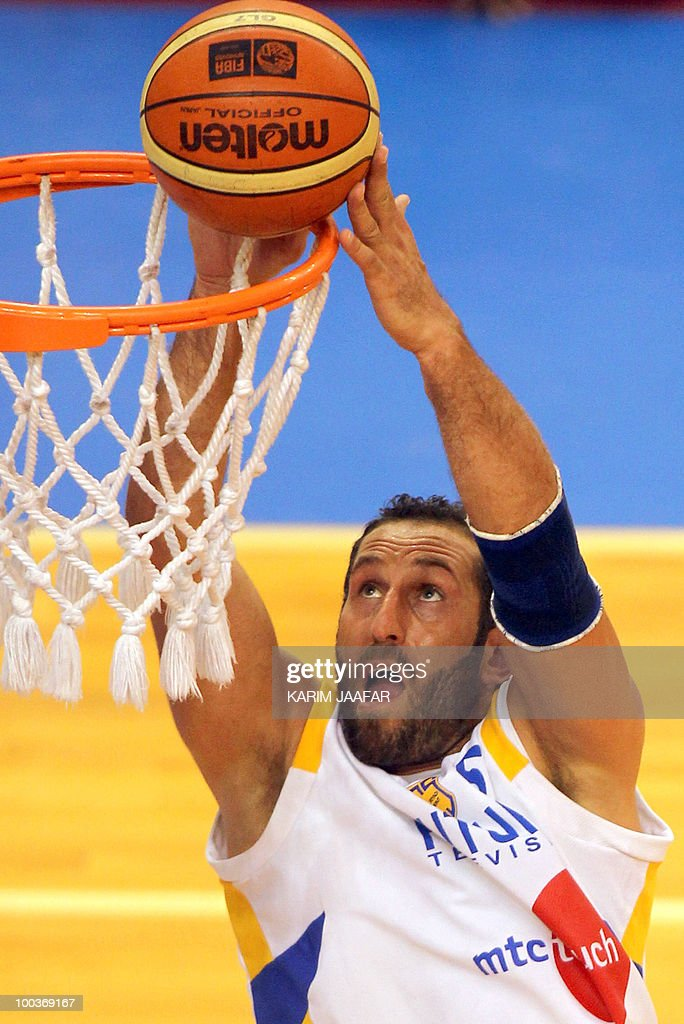 Lebanese al-Riyadi player Fadi el-Khatib dunks to score against Saudi Arabia's al-Hilal club during the 21st FIBA Asia Champions Cup at the al-Gharafa indoors stadium in Doha on May 24, 2010.