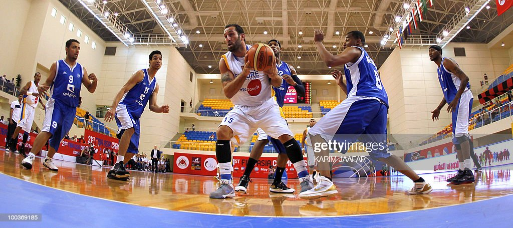 Lebanese al-Riyadi player Fadi el-Khatib (C) surrounded by Saudia Arabia's al-Hilal club players secures the ball during 21st FIBA Asia Champions Cup at the al-Gharafa indoors stadium in Doha on May 24, 2010.