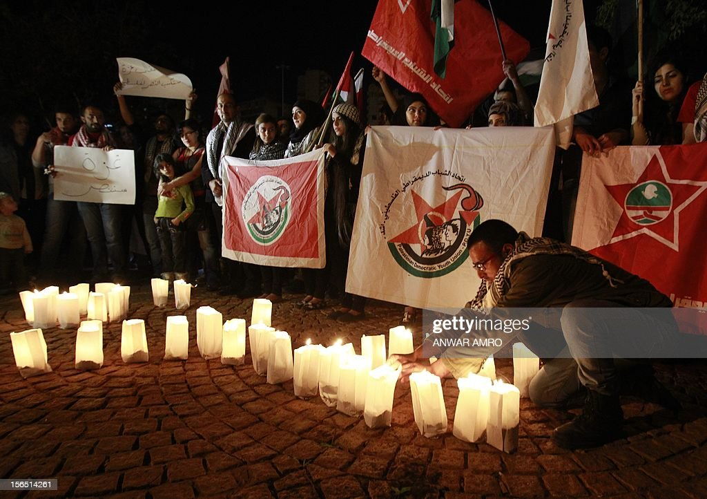 Lebanese and Palestinian demonstrators gather during a protest against the ongoing attack on Gaza outside the offices of the United Nations Economic and Social Commission for Western Asia (ESCWA) in Lebanese capital Beirut, on November 16, 2012. Organised by the Democratic Union of Palestinian Youth and the Democratic Union of Lebanese Youth, the protesters lit up candles spelling out the name of Gaza in Arabic. AFP PHOTO / ANWAR AMRO