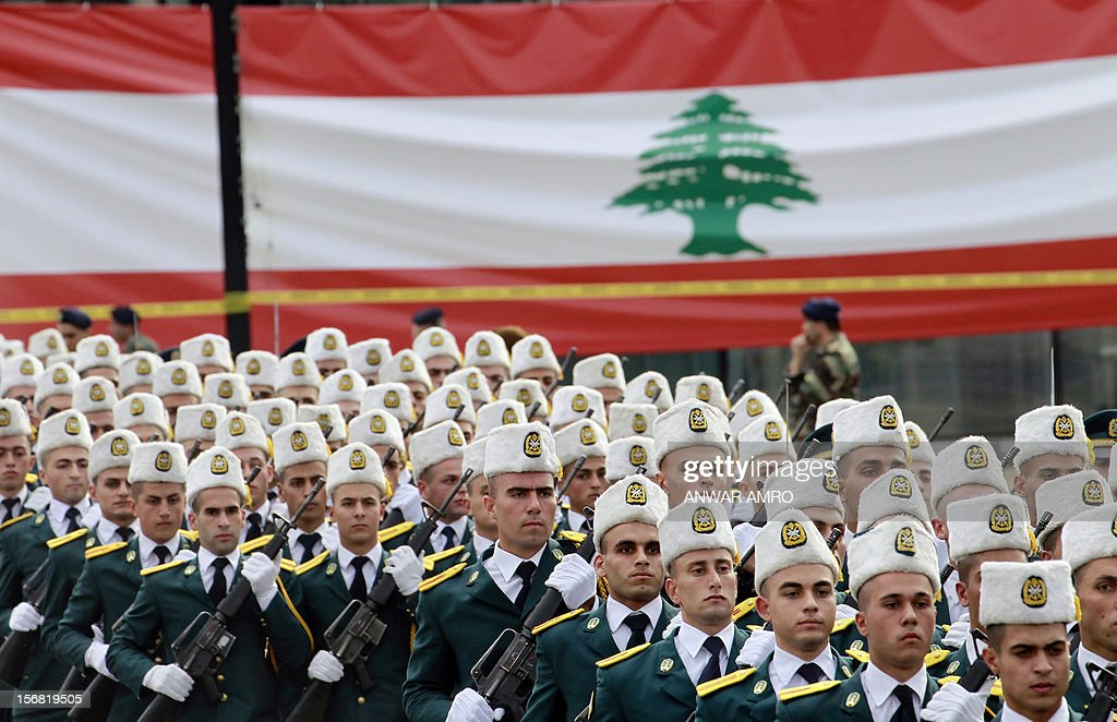 Lebanese army cadets march past a giant national flag during a military parade marking Lebanon's 69th Independence Day in central Beirut on November 22, 2012. Lebanon, a former French mandate, won its independence on November 22, 1943, ending a two-decade rule by France. AFP PHOTO / ANWAR AMRO
