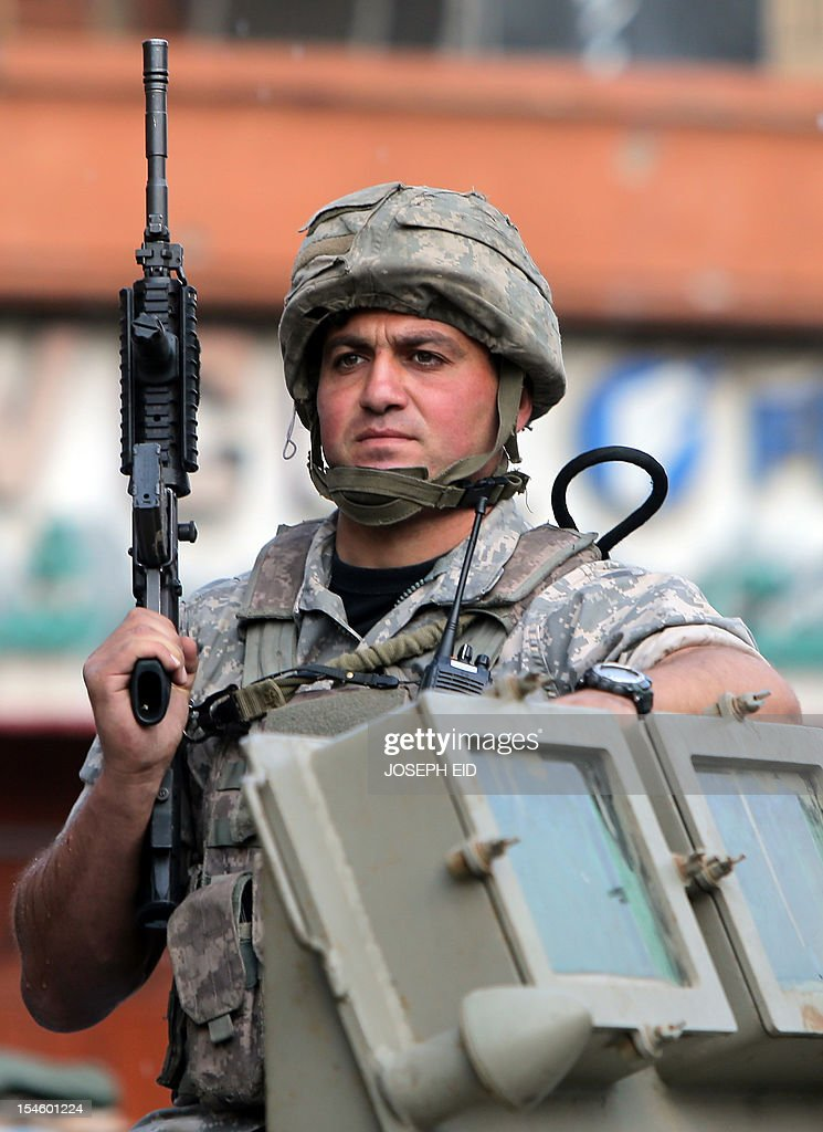 A Lebanese army commando patrols the Bab al-Tabbaneh and Jabal Mohsen neighbourhoods where clashes are taking place between Sunnis and Alawites in the northern city of Tripoli on October 23, 2012. Lebanese troops deployed across the country as more sectarian violence erupted, stoking fresh fears after a top security official was killed in a bombing blamed on neighbouring Syria.
