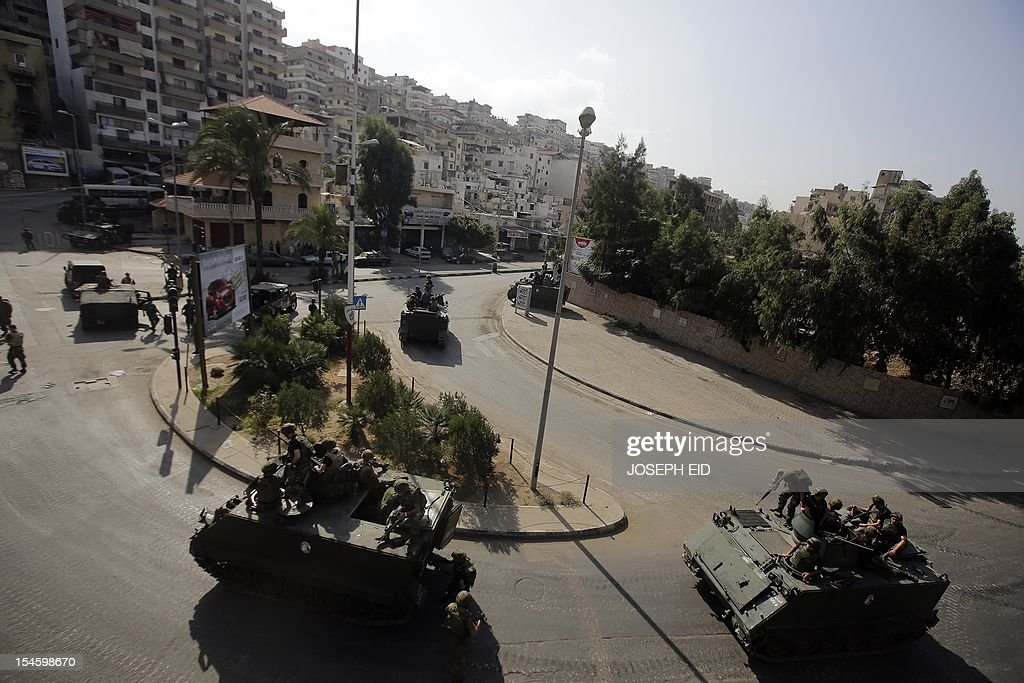 Lebanese army deploy in the Bab al-Tabbaneh and Jabal Mohsen neighborhoods where clashes are taking place between Sunni and Alawites in the coastal city of Tripoli, northern Lebanon, on October 23, 2012. Lebanese troops deployed in Sunni areas of the capital as more sectarian violence erupted, stoking fresh fears after a top security official was killed in a bombing blamed on neighbouring Syria. AFP PHOTO /JOSEPH EID