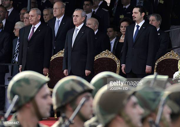 Lebanese army forces march past Lebanese President Michel Sleiman parliament speaker Nabih Berri and Prime Minster Saad Hariri during a military...
