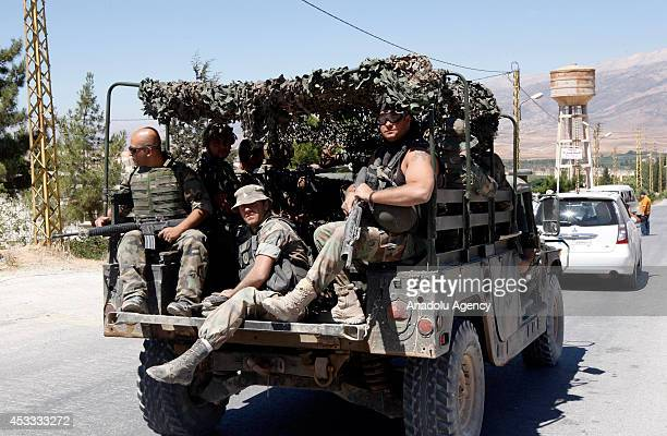 Lebanese army personnel in military vehicles arrive to the northern Lebanese town of Arsal a town on the border with Syria during the temporary...