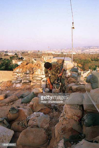 Lebanese Army soldier inspects all that was left of a sandbagged position near Hay el Sellom where 8 US Marines where killed when a shell landed on...