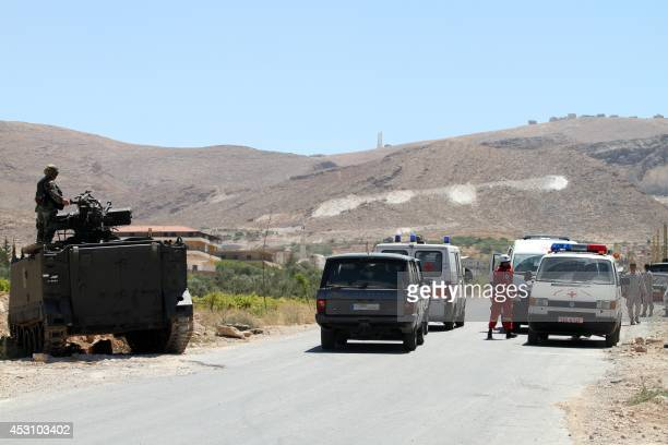Lebanese army soldiers and ambulances drive to the entrance of the town of Arsal in the Bekaa valley on August 3 2014 Gunmen have killed eight...