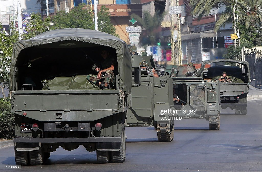 Lebanese army soldiers are deployed to the area of clashes in the Abra district of the southern Lebanese city of Sidon on June 24, 2013. At least sixteen soldiers have been killed in clashes with supporters of Sheikh Ahmad al-Assir in southern Lebanon, the army said, in violence tied to rising sectarian tensions fanned by the Syria conflict.