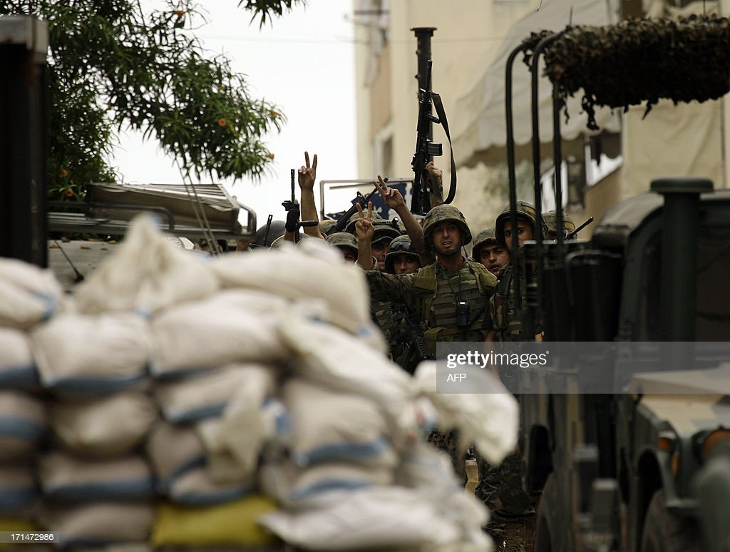 Lebanese Army soldiers cheer as they secure the Bilal bin Rabah mosque in the Abra district of the southern city of Sidon on June 25, 2013, after troops seized control of the headquarters of a radical Sunni sheikh whose supporters battled the army for two days, killing 16 soldiers.