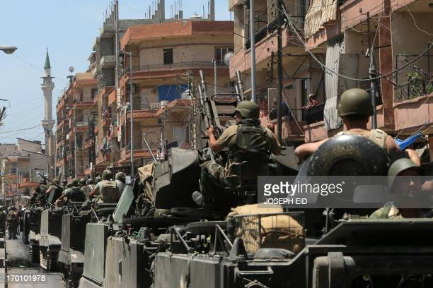 Lebanese army soldiers deploy in Syria street in Tripoli's Sunni neighbourhood of Bab alTabbaneh to restore a tense calm four hours after the clash...
