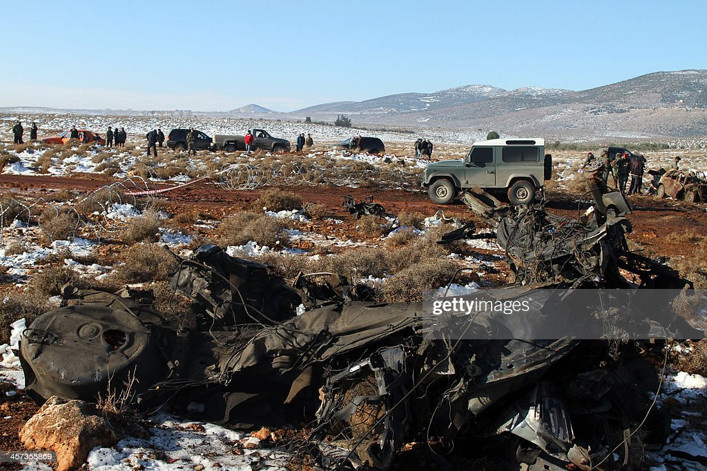 Lebanese army soldiers gather at the site of an explosion in the village of Sbouba east of Baalbek in Lebanon's Bekaa valley, on December 17, 2013. A car exploded near a Hezbollah checkpoint in eastern Lebanon early in the morning, causing both deaths and injuries, a security source told AFP on condition of anonymity.