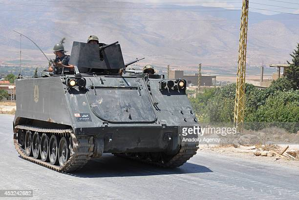 Lebanese army soldiers in an armoured vehicle arrive in the northern Lebanese town of Arsal a town on the border with Syria during the temporary...