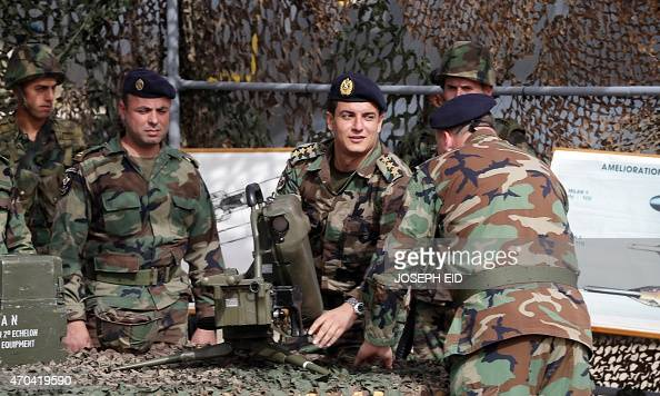 Lebanese Army soldiers inspect an antitank missile launcher 'Milan' during a handover ceremony of a shipment of French weapons to the Lebanese Army...