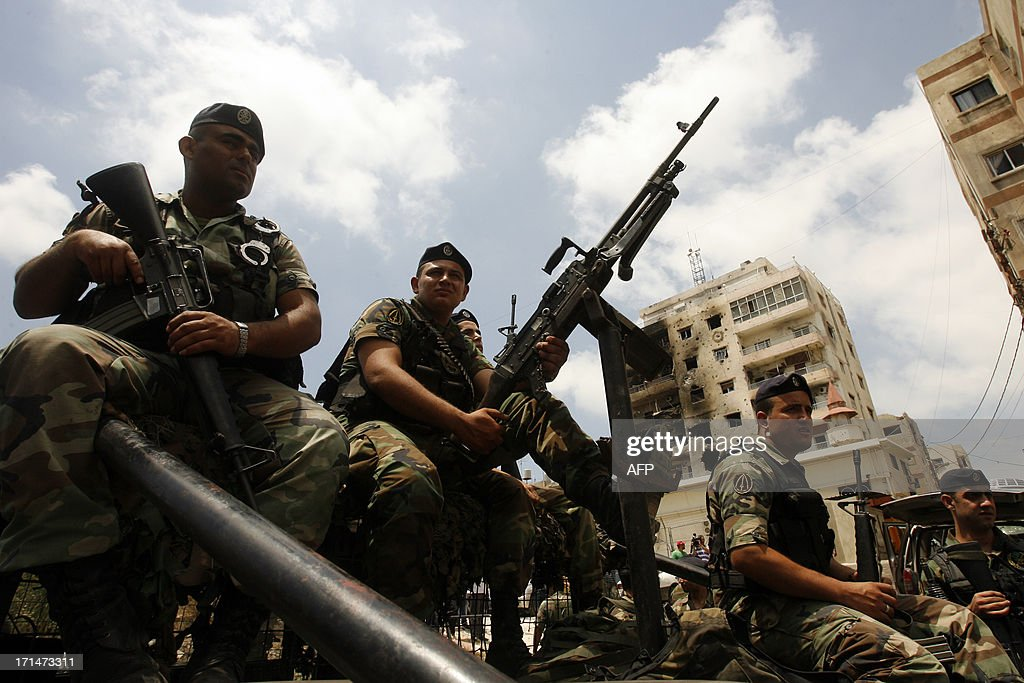 Lebanese Army soldiers patrol the area around the Bilal bin Rabah mosque in the Abra district of the southern city of Sidon on June 25, 2013, after troops seized control of the headquarters of a radical Sunni sheikh whose supporters battled the army for two days, killing 16 soldiers. AFP PHOTO/MAHMOUD ZAYYAT